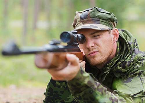 Hunter with Eye on Gun Scope